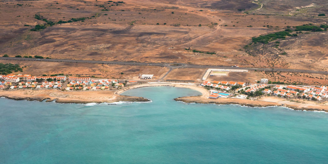 Aerial view of town by seashore