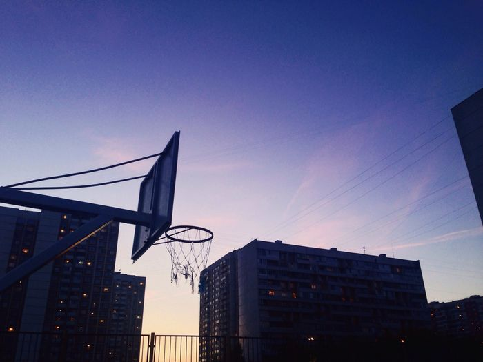Architecture Basketball Hoop Building Exterior City Built Structure Low Angle View Outdoors No People Sunset Clear Sky Sky Cityscape OpenEdit Taking Photos Photography Hello World Skyscraper EyeEmNewHere