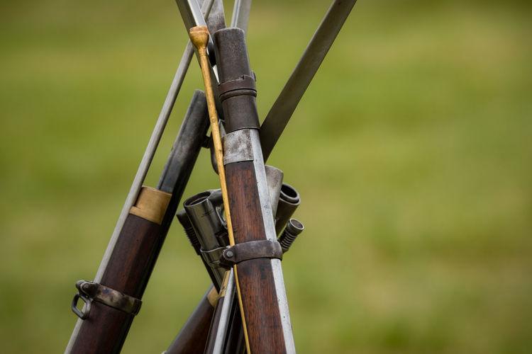 Close-Up Of Rifles
