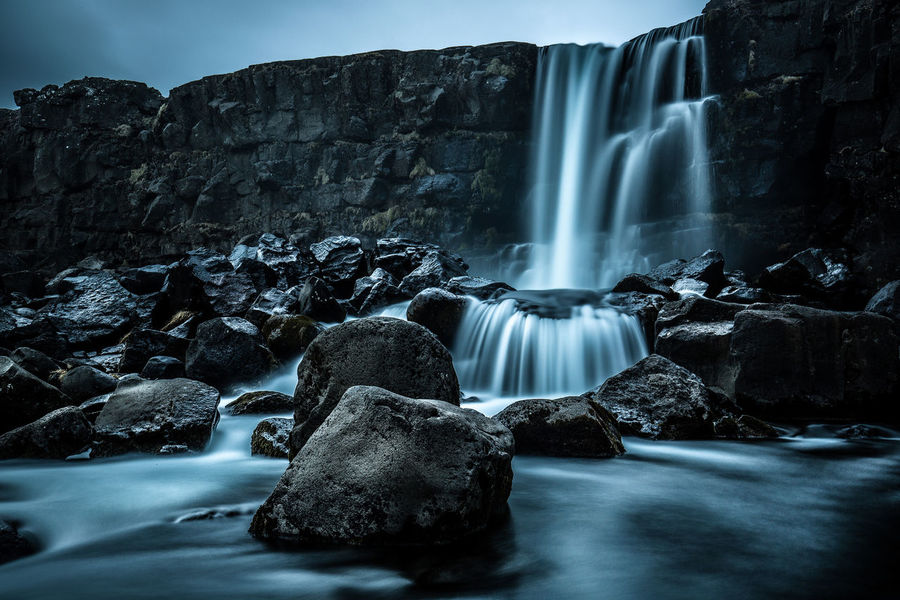 Iceland Beauty In Nature Blurred Motion Day Long Exposure Low Angle View Motion Nature No People Outdoors Oxararfoss Rock - Object Scenics Sky Water Waterfall