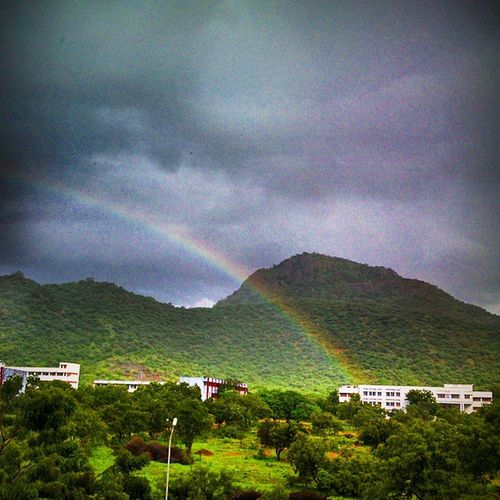 That's an adorable piece of beauty in the art of nature's hands.. A rainbow.. shot using mobile.. never mind the poor quality?? Vscocam Naturelovers Sujansuresh First Eyeem Photo antique motoX Googlephone nature sky clouds rainbow igram igdaily holidays sujansuresh