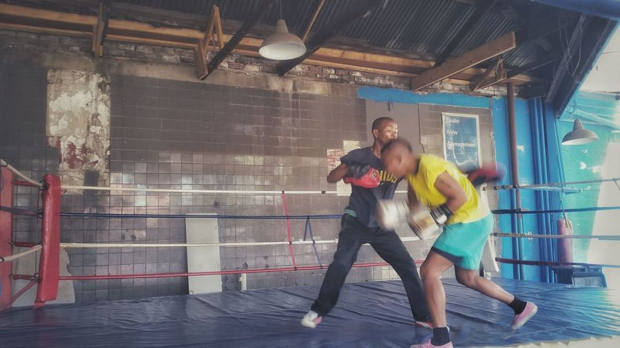 Young Adult Young Women Females People Sport Exercising Adult Two People Togetherness Women Activity Indoors  Friendship Full Length Adults Only Healthy Lifestyle Sports Clothing Lifestyles Coach Teamwork Boxing Boxing Ring Yellow Flower Yellow Color Boxing Gym