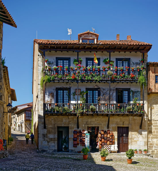 Satillana de Mar, Cantabria, Spain Architecture Cantabria Sunny Balconies Blue Sky Flowers House Santillana Del Mar Stone Village Tiled Roof  Traditional Building