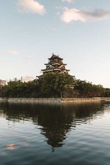 Sunset glow by the castle in Hiroshima, Japan Blue Hour Japan Photography Japanese Castle Japanese Culture Japanese Pagoda Pagoda Sunset Glow Travel Photography Ancient Architecture Architecture Cloud - Sky Cloudy Sunset Famous Travel Destination Hiroshima Hiroshima Castle No People Pagoda Peaceful Landscape Reflection In The Water Reflections And Shadows Reflections In The Water Sunset Travel Destinations Travel Photographer Wide Angle EyeEmNewHere