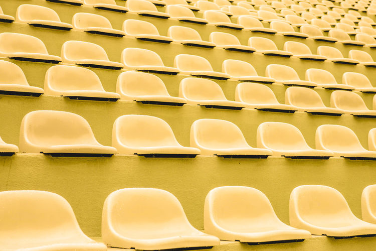 Paint The Town Yellow Abundance Arrangement Auditorium Backgrounds Chair Conformity Day Full Frame In A Row Indoors  Large Group Of Objects No People Order Repetition Seat