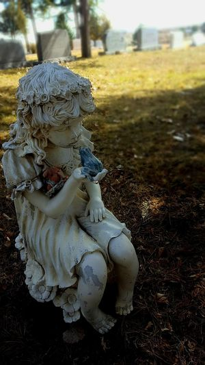 Statuette in the shadows Cemetary Photography Day Frog In Hand Graveyard No People Outdoors Shadows & Light Sunny Day
