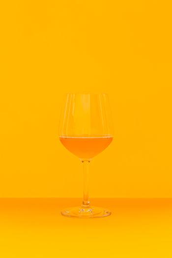 Wineglass on yellow background