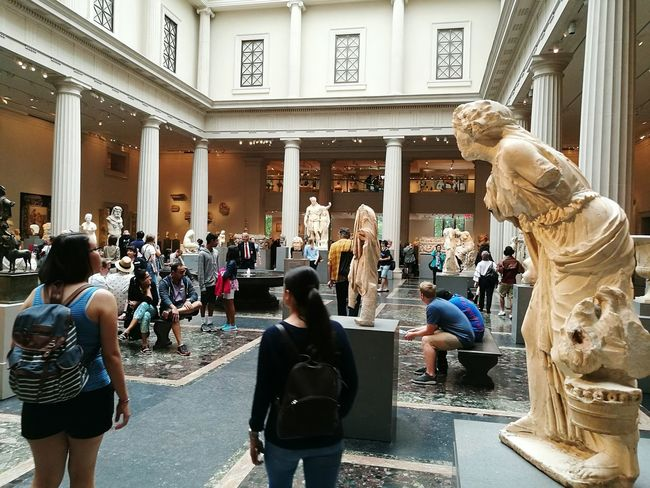 Indoors  Lifestyles Statue Arts Culture And Entertainment Leisure Activity People Architecture Built Structure Men Large Group Of People Day Sculpture Adult Adults Only City Politics And Government Only Men Ancient Greek Culture New York City Metropolitan Museum Of Art Travel Destinations