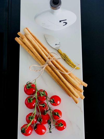 High angle view of cherry tomatoes and cinnamons