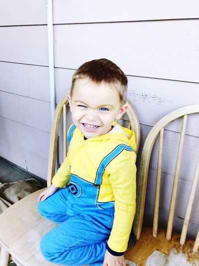 Selected For Premium. Selected For Premium Childhood Looking At Camera Portrait One Person Smiling Cute Day Happiness Sitting Toddler Boy Boy Squinting Close Up Short Hair Cute Boy Halloween Halloween Costumes Close-up Smile Toddler  Dressing Up Trickortreat Outdoors Sitting Outside Blue Eyes