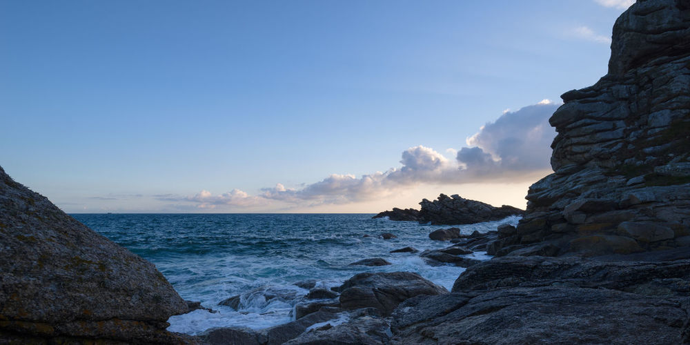 Panoramic view over the rocky Breton coast in the soft light of sunrise, France, Brittany, Finistere Sea Sky Water Rock Solid Rock - Object Scenics - Nature Horizon Over Water Beauty In Nature Tranquil Scene Tranquility Nature Beach Land No People Rock Formation Outdoors Rocky Coastline France Bretagne Bretagnetourisme Finistere Blue Sky Wave Tide Coastline Rock Formation