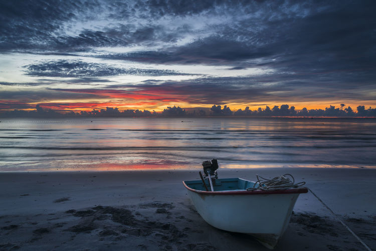 Beautiful Dawn in Hua Hin, Thailand Beach Beauty In Nature Cloud - Sky Idyllic Land Nature Nautical Vessel No People Non-urban Scene Orange Color Reflection Scenics - Nature Sea Sky Sunset Tranquil Scene Tranquility Water