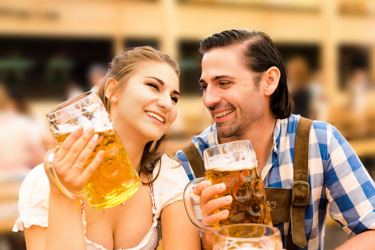 Young Couple Enjoying Beer At Restaurant