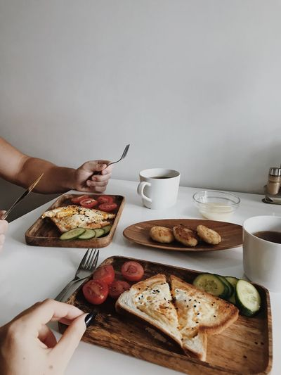 Cropped image of man having breakfast