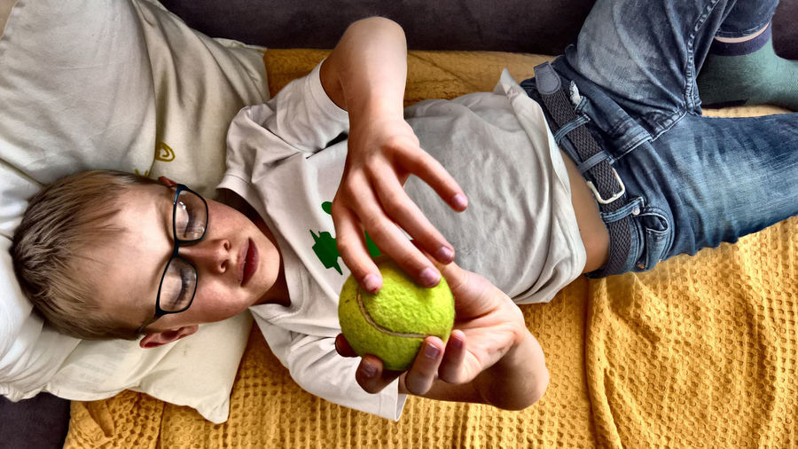 16x9 HDR Happiness Hdr_Collection Males  Tennis Ball Boy Casual Clothing Child Childhood Emotion Holding Indoors  Leisure Activity Lifestyles Lying Down People People Photography Positive Emotion Relaxation Smiling Togetherness Wellbeing