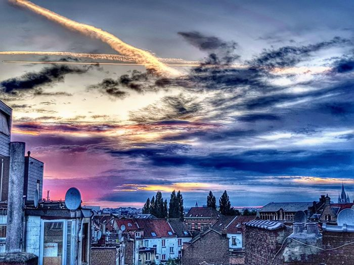 Panoramic view of cityscape against sky during sunset