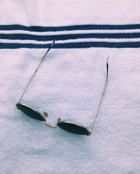 High angle view of sunglasses on textile
