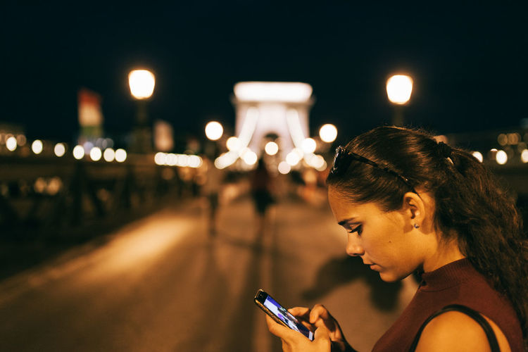 Siummer nights Bridge Brunette Budapest City City Life EyeEm Best Shots Facial Expressions Focus On Foreground Headshot Illuminated Leisure Activity Lights And Shadows Night Nightphotography Onthephone Side View Sky TeamCanon Weekend Activities Young Adult The Color Of Technology People And Places