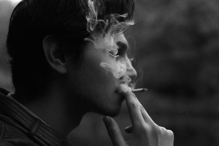 Side view of man smoking