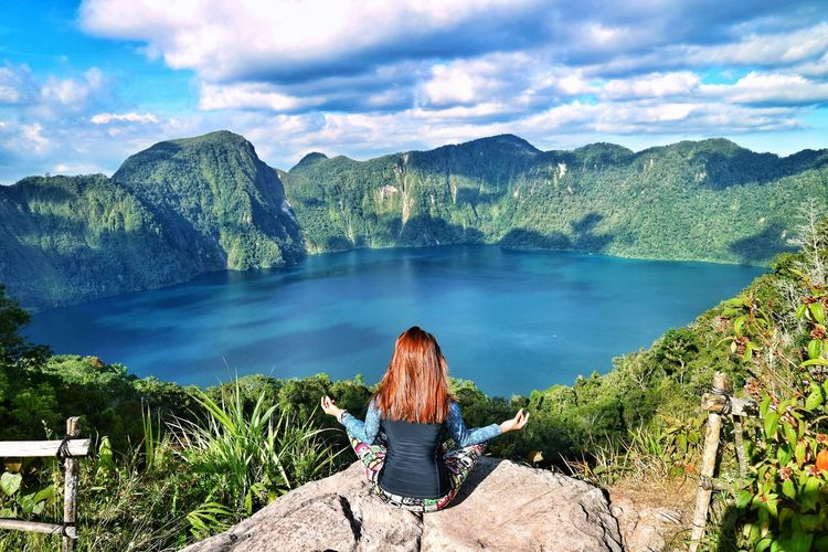 "Majestic ""Lake Holon"" Crater Water Mountain Women Young Women Lake Adventure Rear View Sitting Sky Landscape Backpack Hiker Wonderlust Explorer Mountain Climbing Tranquil Scene Mountain Range Hiking Pole Exploration Looking At View"