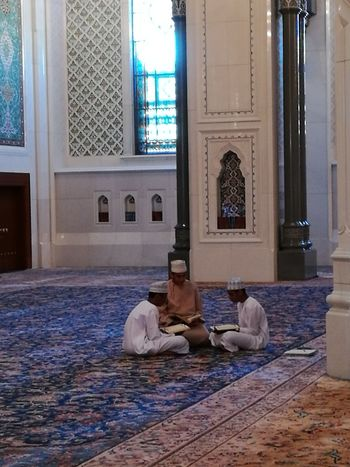 Muscat, Oman. Particolare della Grande Moschea. Indoors  People Men Travel Tourism Architecture And Art Architecture Praying Muscat Mosque Carpet Muscat , Oman Mascate Teaching