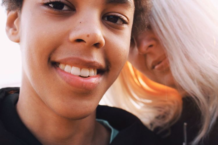 Close-Up Portrait Of Son With Mother