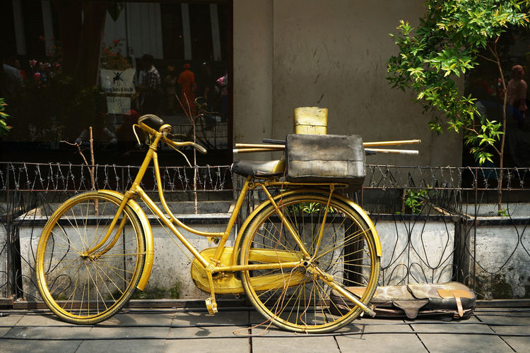Golden bicycle Transportation Bicycle Mode Of Transportation Land Vehicle Building Exterior City Day Street Sidewalk Yellow Parking Golden