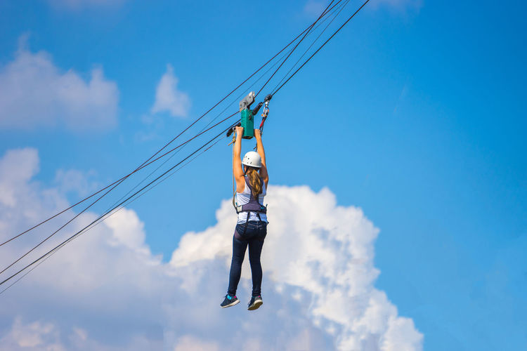 Athletic Athletics Fun Hanging Low Angle View Rope Skill  Woman Adventure Blue Cloud - Sky Clouds Dengerous Girl Only One Outdoors Outside person Sky Sports Summer