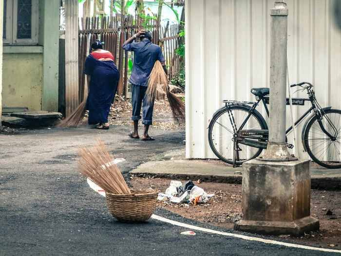 city cleaners .. Abandoned Absence Bad Condition Bicycle Casual Clothing Full Length Leisure Activity Lifestyles Men Obsolete Occupation Real People Rear View Side View Standing Street Sweepers Sweeping Walking Wall Women Tamilnadu Chennai Tadaa Community Road
