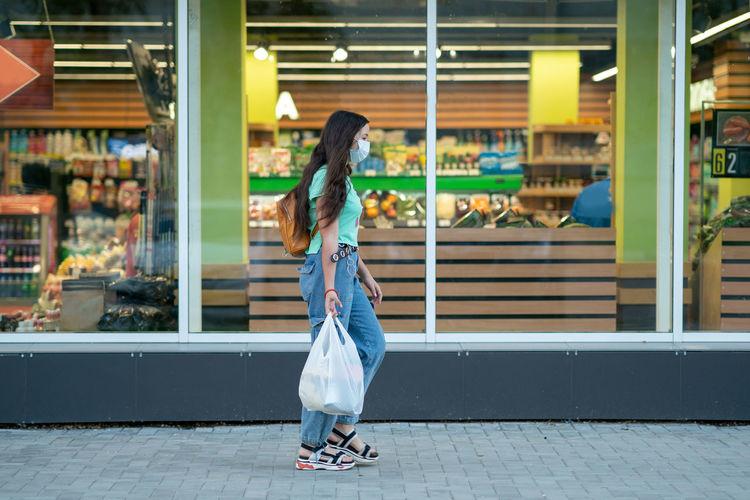 Rear view of woman walking in store