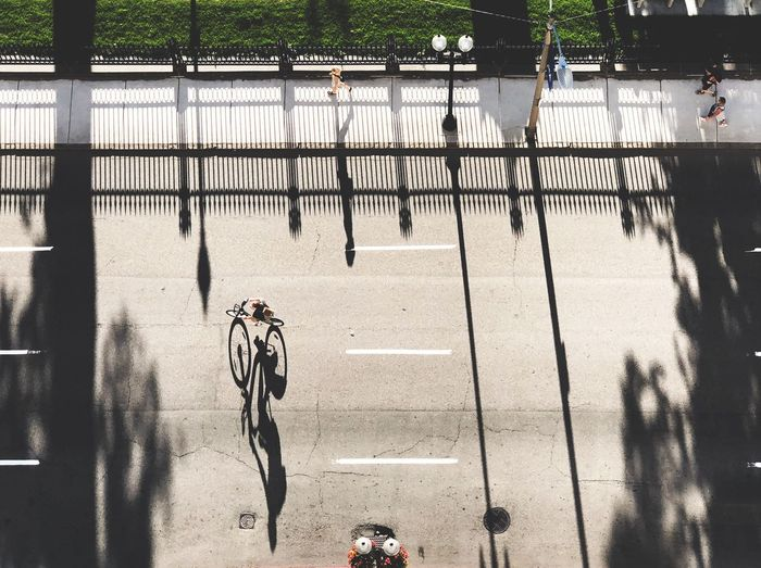 Shadows The Street Photographer - 2018 EyeEm Awards The Traveler - 2018 EyeEm Awards Sunlight Shadow Day Nature Barrier Fence Boundary High Angle View City Bicycle Street Sunlight Shadow Day Nature Barrier Fence Boundary High Angle View City Bicycle Street #urbanana: The Urban Playground Summer In The City