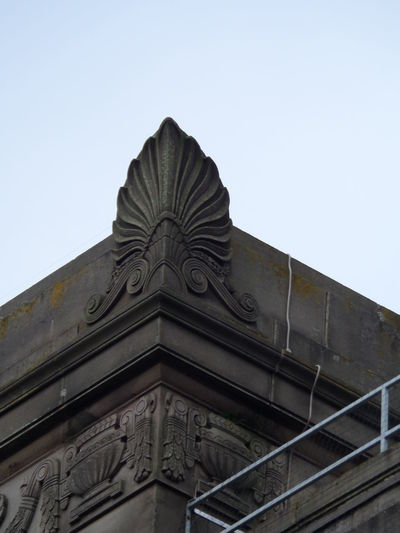 Acanthus Leaf Carved Stone Feature. Architectural Feature Architecture Building Building Exterior Built Structure Clear Sky Decoration. Design Façade Greek. High Section History No People Ornate Outdoors