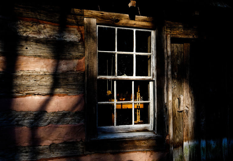 Looking in Architecture Window Built Structure Building Building Exterior No People Wood - Material Old House Door Outdoors Entrance Abandoned Shadow Wall Residential District Wall - Building Feature Reflection Window Frame Log Cabin