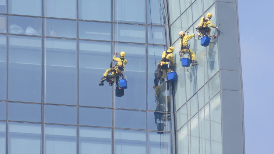 cleaning jobs on a skyscraper Action Building Exterior Clean Cleaner Climbing Danger Dangerous Glass Job Men At Work  Occupation RISK Skyscraper Uniforms Urban Washer Whashing Work
