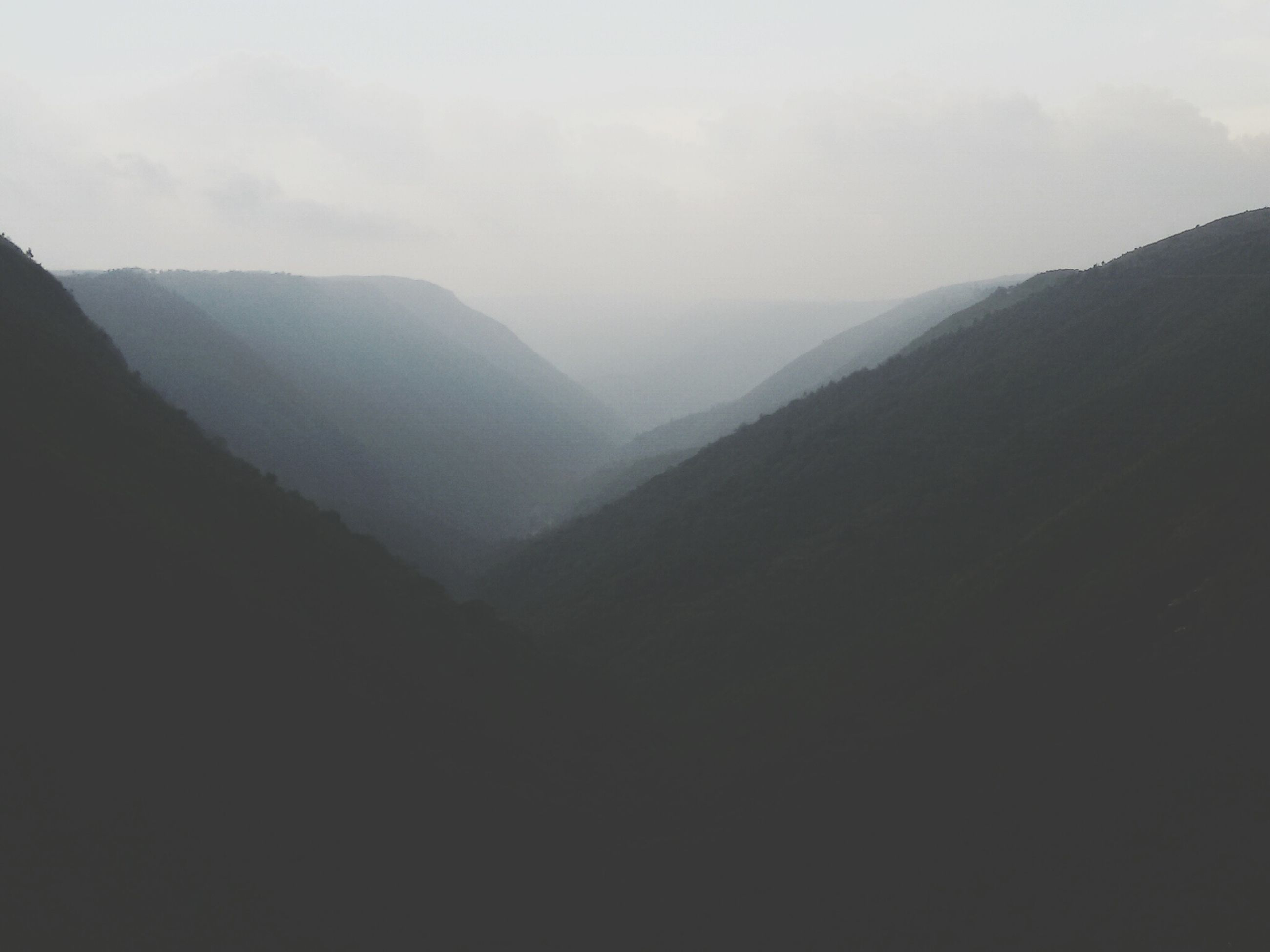 mountain, mountain range, tranquil scene, tranquility, scenics, beauty in nature, fog, landscape, nature, sky, non-urban scene, idyllic, remote, physical geography, majestic, foggy, outdoors, weather, no people, day
