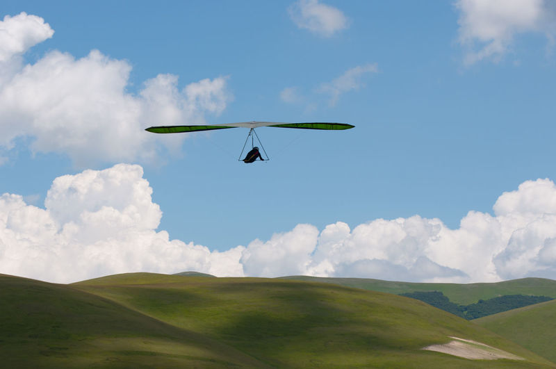 Hangglider Hang Glider Agriculture Beauty In Nature Blue Business Finance And Industry Castelluccio Di Norcia Day Field Flying Green Color Hangglider Hanggliding Innovation Landscape Nature No People One Person Outdoors Rural Scene Silence Silence Moment Sky
