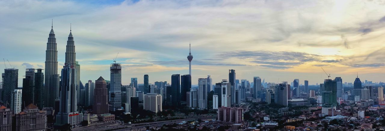 City Cityscape Skyscraper Urban Skyline Building Exterior Architecture Travel Destinations Travel Sky Modern Outdoors Sunset Downtown District Tower City Life Built Structure Cloud - Sky No People Day Kuala Lumpur Kuala Lumpur Malaysia  KLCC Twin Towers Kltower