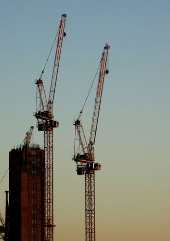 Clear Sky Sunset No People Built Structure Outdoors Architecture Day Building Exterior Tower Cranes