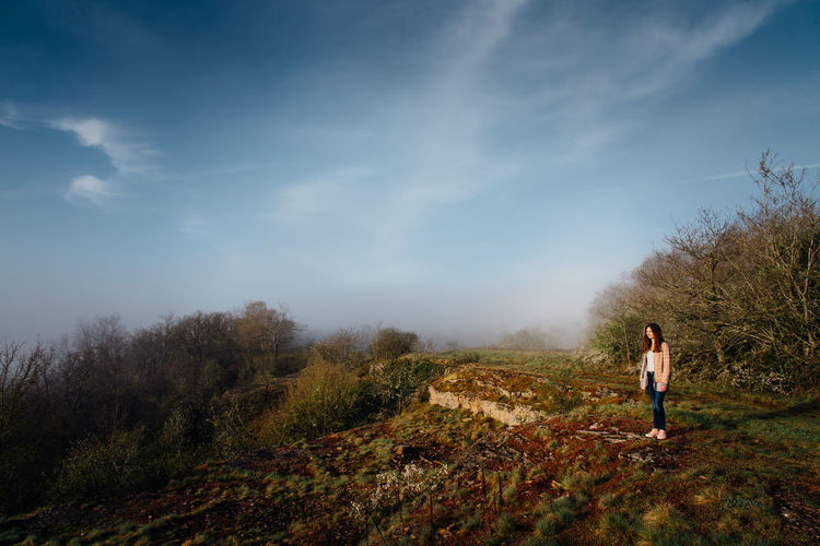 Girl Real People Foggy Fog Landscape Cliff Nature One Person Trekking Leisure Activity Thinking Alone Full Length Standing Plant Tranquility Sky Beauty In Nature Scenics - Nature Land Non-urban Scene Day Lifestyles Casual Clothing Tranquil Scene Tree Women Outdoors Woods Countryside Autumn Mood