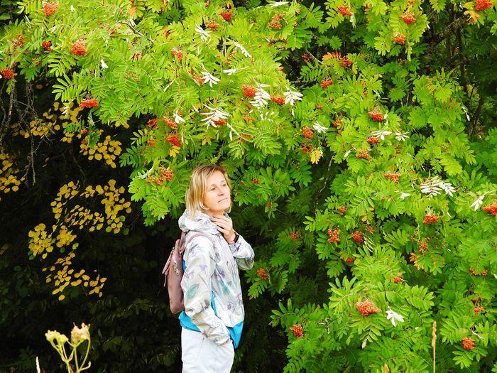 Full length of girl standing on flowering plants