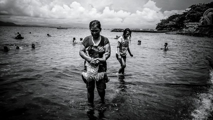 Beauty In Nature Beach People Day Sea Momanddaughter Baby Blackandwhite Picoftheday TheWeekOnEyeEM Popular Photos The Photojournalist - 2017 EyeEm Awards