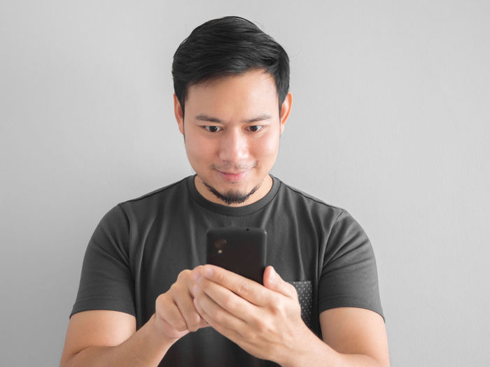 Asian  Man Use Smartphone Touch Touching Technology Chat Social Thai Portrait
