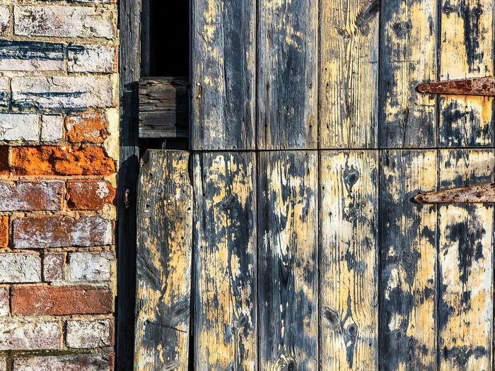 Old wooden door. Full Frame Backgrounds Pattern No People Wall - Building Feature Built Structure Architecture Textured  Building Exterior Wall Weathered Close-up Day Sunlight Outdoors Old Deterioration