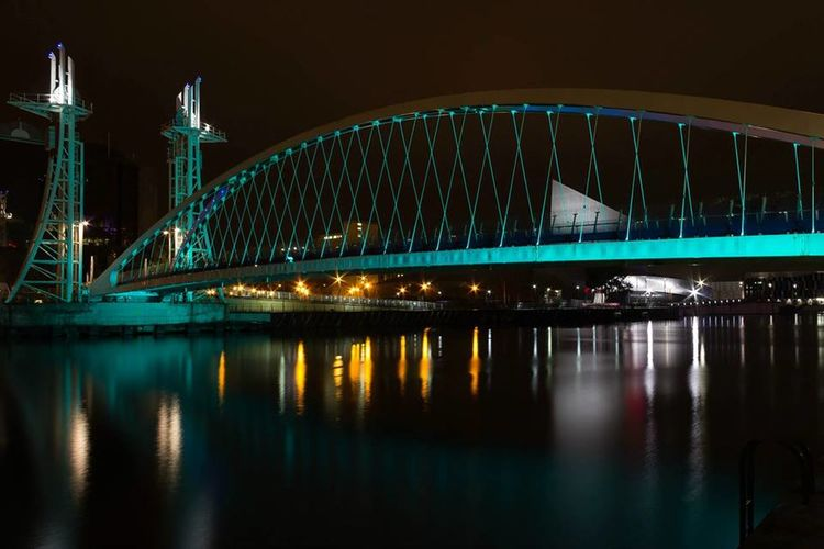 Illuminated salford quays lift bridge at night