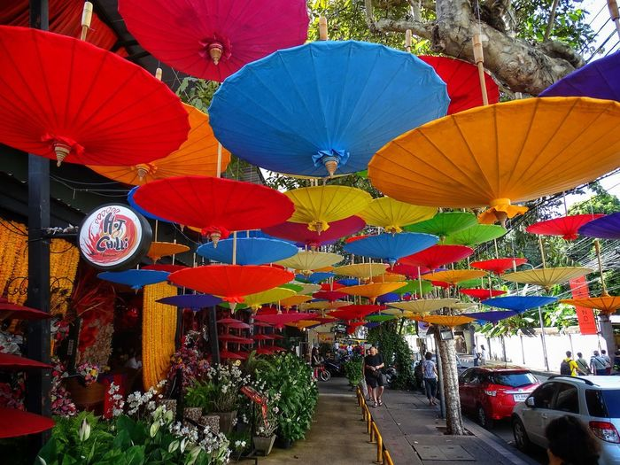 Colorful lanterns hanging in row