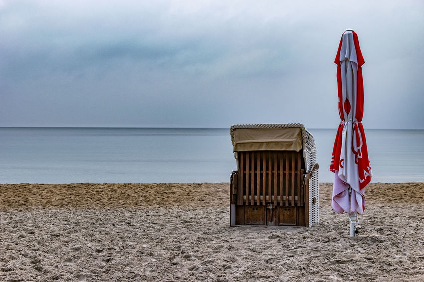 closed Baltic Sea Beach Beach Chair Blue Calm Sea Chillen Early Morning Holidays Horizon Over Water Morning Light No People Parasol Sand Sea Sky Tourism Water