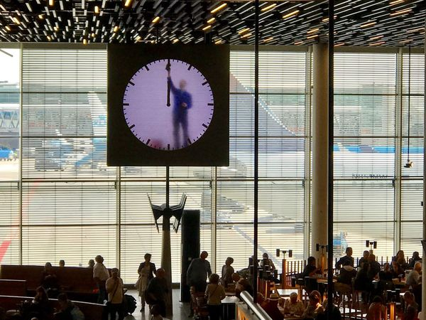 Cleaning the clock... Amsterdam Airport Schiphol Be. Ready. Airport Clockwork Cleaning Time People And Places Working Cleaning Tourist Destination Travel Destinations Transportation Airplanes Peculiar Work in Amsterdam Schiphol Airport