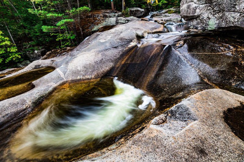 Beauty In Nature Blurred Motion Day Falling Water Flowing Flowing Water Forest Land Long Exposure Motion Nature No People Outdoors Plant Power In Nature Rock Rock - Object Scenics - Nature Solid Stream - Flowing Water Tree Water Waterfall