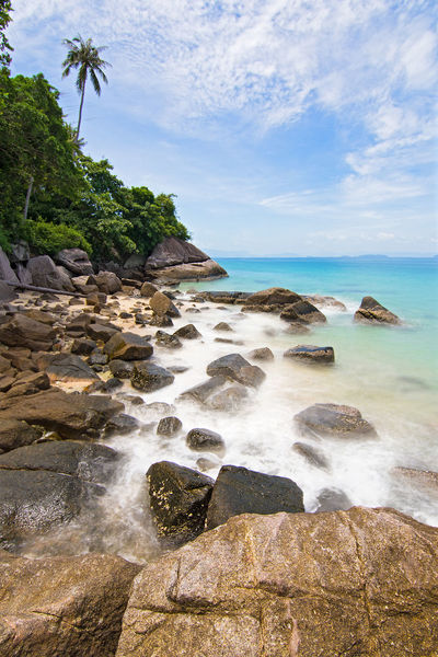 Isolated tropical rocky beach, Perhentian island. Golden Isolated Palm Tree The Week On EyeEm Blue Clouds Empty Golden Sand Landscape Long Exposure Motion Paradise Rock - Object Rocks Rocks And Water Sand Tranquility Travel Destinations Turquoise
