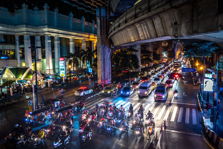 Bangkok ~ City of (Night) Life Architectural Column Architecture Building Exterior Built Structure Car City City Life City Street Crowd Group Of People High Angle View Illuminated Land Vehicle Light Mode Of Transportation Motion Motor Vehicle Night Nightlife Road Street Traffic Transportation Capture Tomorrow